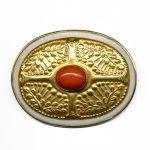 In 1921 Märtha Af Ekenstam designed this gold art deco brooch, a stylized and symmetric Celtic rowan design with a precious coral berry.
